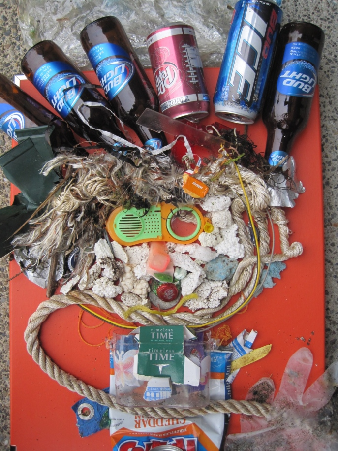 The Trashman of Wauna. Beach trash art.