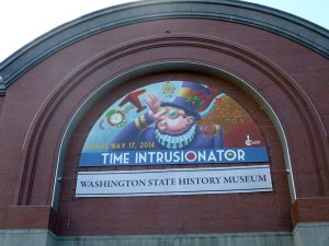 Thanks to the wonderful art of Mike Cressy and the graphic wizard of Gwen Whiting we're gonna have a show! Photo by Gwen Whiting of the exhibit banner at the Washington State History Museum in Tacoma.