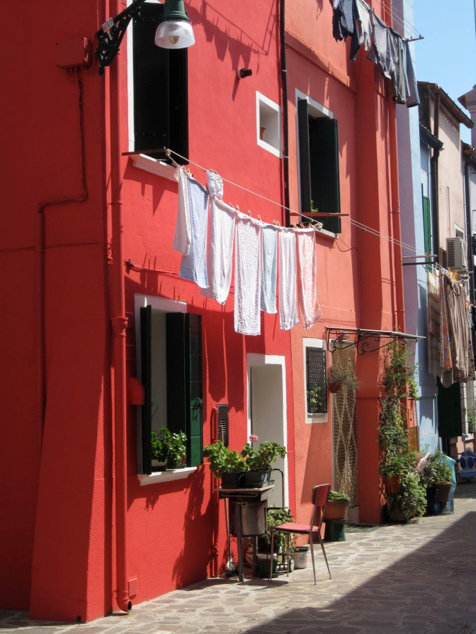Doing laundry on Burano. Nobody here is afraid of color.